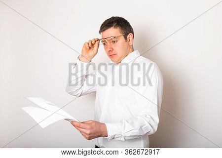 Portrait Of Funny Caucasian Businessman Shocked Surprised With Open Glasses  To See Financial Report