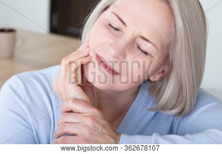 Teeth Problem. Woman Feeling Tooth Pain. Closeup Of Beautiful Middle-aged Suffering From Strong Toot