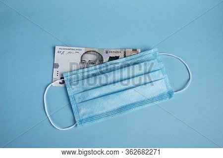 Face Mask And Five Hundreds Hryvnas Isolated On Bright  Background. Piece Of Personal Protection Dur