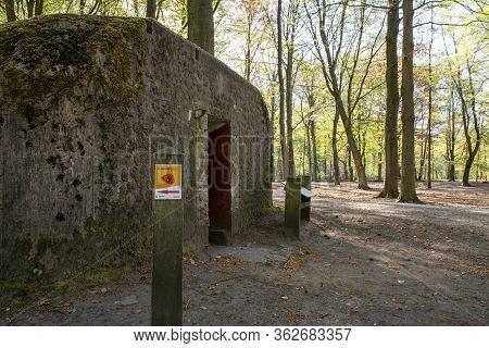 Kapellen, Belgium, April 2020: Ww1 Bunker Located In Mastenbos On The Historical Flanders Fields Sit
