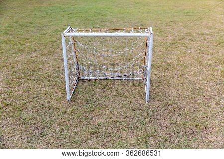 Mini Soccer Goal On The Green Grass Field. Outdoors Mini Football Court. Mini Football Goal.