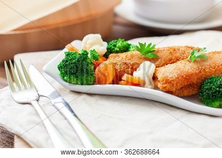 Two Slices Of Steak Or Ham With A Slice Of Cheese In Between, Fried In Breadcrumbs