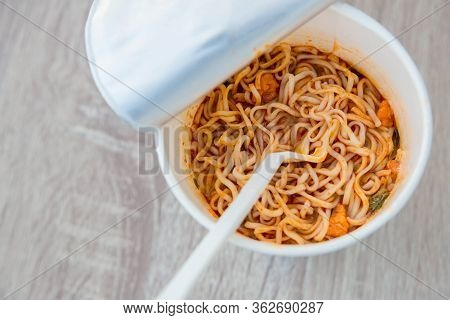 Hot Noodle Cup. Noodle Cup Ready Made. Eating Instant Noodles With A Plastic Fork. Junk Food Instant