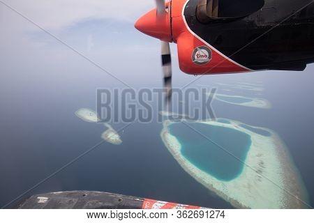 Ari Atoll, Maldives - 05.05.2018: Maldives Seaplane Flying Over Maldives Island. Transmaldivian Airl