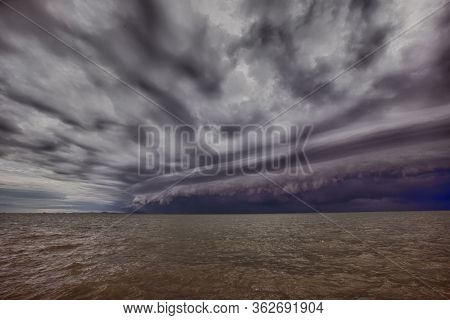 Cloudy Storm In The Sea Before Rainy.tornado Storms Cloud Above The Sea. Monsoon Season.