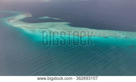 Tropical Islands And Atolls In Maldives From Aerial View. Famous Travel Destination And Luxury Vacat