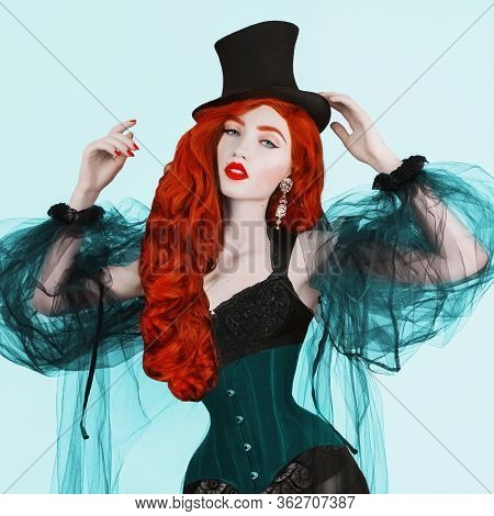 Redhead Woman With Red Lips In Black Top Hat. Girl With Red Hair And Pale Skin. Redhead Woman In Bla