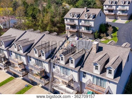 Morgantown, Wv - 22 April 2020: Aerial View Of Roofing Contractors Replacing The Old Shingles On A T