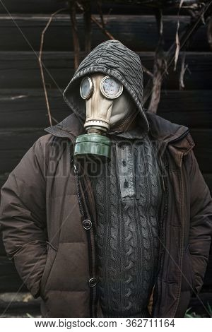 Portrait Of A Man In A Gas Mask. Panic During Quarantine. Coronavirus Pandemia Concept. Stalker In A
