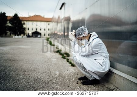 Depressed Crying Doctor With Mask Having Mental Breakdown.fear,anxiety,panic Attack Due To Coronavir