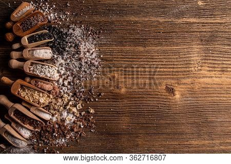 Assorted Gourmet Salts In Scoop With Copy Space On Wooden Background