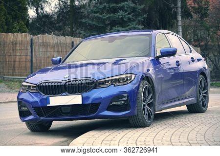 Krakow, Poland 22.03.2020: Blue Car Bmw 3 G20 Luxury German Sedan, Parking In City Park. Detail Fron