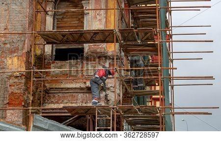 Building Facade Renovation, Old House Reconstruction, Repair. Scaffold In Front Of Building Facade.