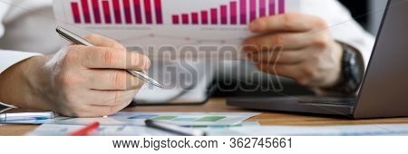 Businessman Reviews Statistical Financial Report. Conducting Business Statistics. Application Specif