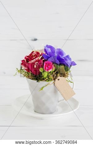 White Vase With Rose Flowers And A Tag For The Inscription.