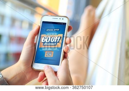 60% Off Sale. Woman In A Hammock With A Smartphone With A 60% Discount Advertising On The Screen.  M