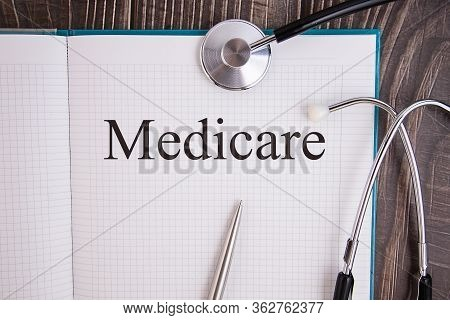Notebook Page With Text Medicare, On A Table With A Stethoscope And Pen, Medical Concept.