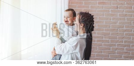 Young Girl Hugs Little Boy, Mother Hugs Her Son, Adoptive Mother With An Adopted Child, Childrens Dr