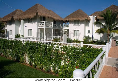 White Stucco Bungalows In Cozumel