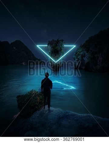 Imaginary World - Wanderer Standing On A Rock In A Futuristic Alien World And Watching An Illuminate