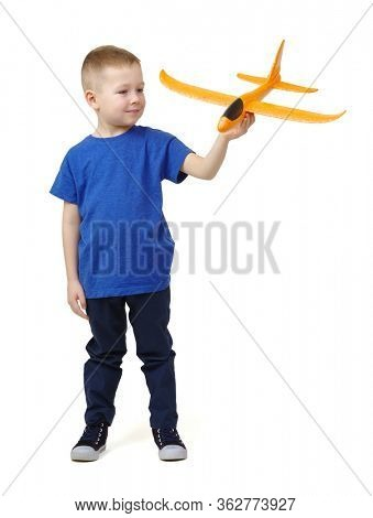 Little boy playing with a toy airplane. Isolated on white background