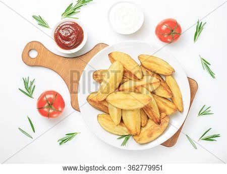 Fried Potato Wedges. Ruddy Baked Potato Wedges With Rosemary And Tomato On A White Background. Flat