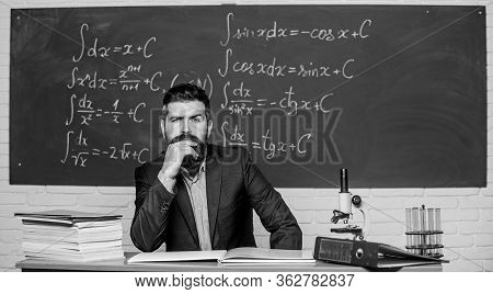 Thinking On Serious Problem. Serious Teacher Touching Beard By Hand. Bearded Man With Serious Face S