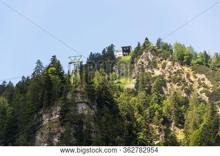 Gosaukammbahn Cable Car Over Vorderer Gosausee Lake Under Donnerkogel Mountain In Gosau, Austria