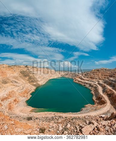 Emerald Lake In A Flooded Quarry. Emerald Green Lake In Flooded Opencast Mine, Open Pit. Oval Lake I