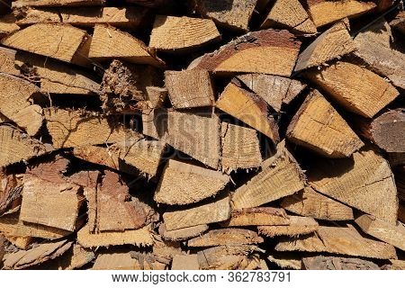 Texture Of Pine Firewood. Chipped Firewood Is On The Heap. Woodpile Of Firewood Close-up. A Stack Of