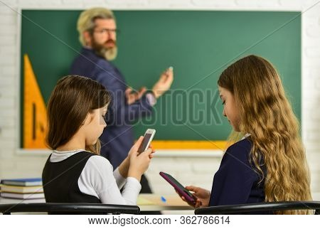 Internet Surfing Social Networks. School Students And Teacher. Addicted To Internet Online Games. Pr