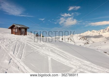 Halting Of The Skiers On Snow In The Mountains. Landscape, Snow, Winter