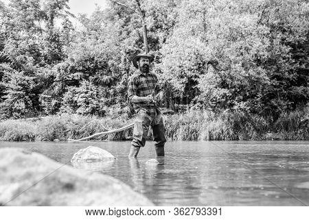 Fish Farming Pisciculture Raising Fish Commercially. River Lake Lagoon Pond. Trout Farm. Fisherman A