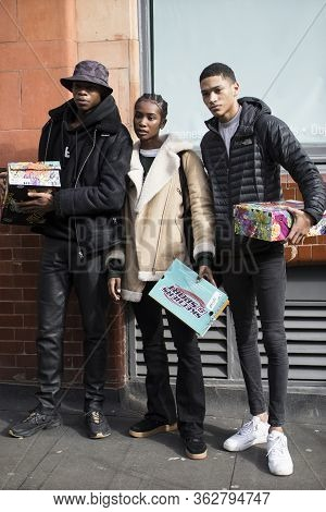 London, Uk - 15 January, 2020, Fashionable People On The Street . Street Style. Three Stylishly Dres