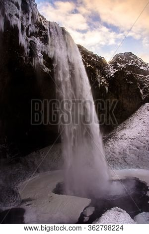 Powerful Seljalandsfoss Waterfalls In A Freezing Winter Day, Iceland, Europe.