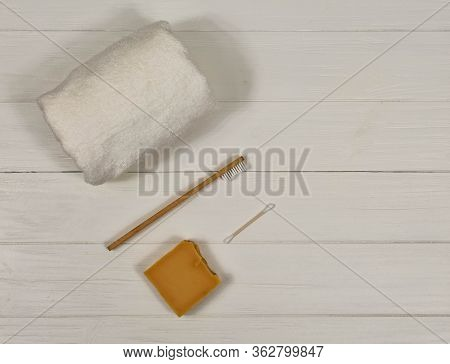Zero Waste Concept. Toothbrush, Towel And Soap On A White Background. Eco-friendly Bamboo Toothbrush