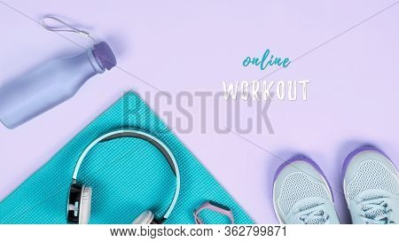 Fitness Equipment And Workout Accessories With Clothes Flat Lay. Online Workouts At Home During Quar