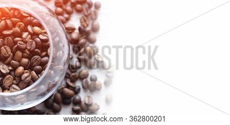 Coffee Beans Are Scattered On A Light Background . Fresh Coffee Beans. Concept Of Advertising Coffee