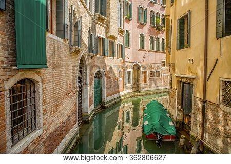 Italian Waterway Between The Houses In Venice
