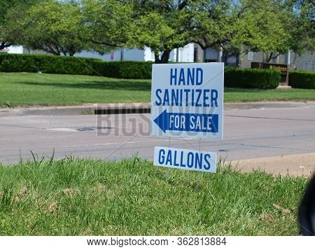 Hand Sanitizer Sign In An Industrial Park Where A Cosmetic Firm Changed Over To Produce A Much Neede