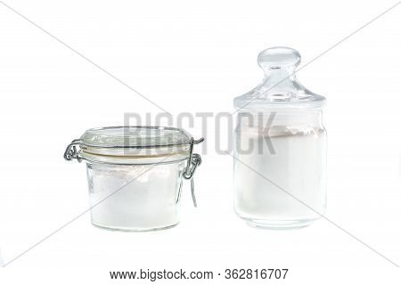 Glass Jar With Corn Starch Isolated On A White Background.