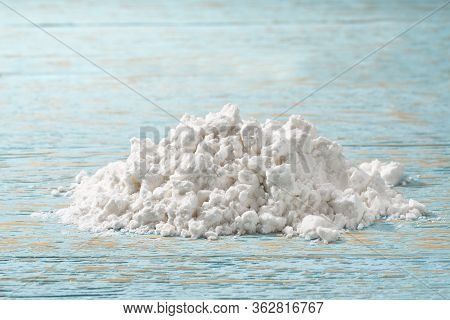Pile Of Potato Starch On A Wooden Table.