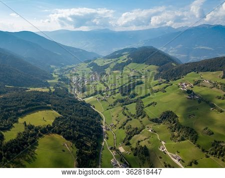Santa Magdalena Village In Val Di Funes On The Italian Dolomites. Autumnal View Of The Valley With C