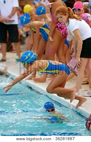 Youth Swimmer Dives Into Pool During Swim Meet
