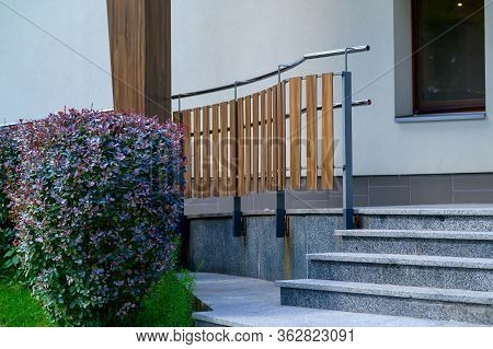 Iron Railings With Wooden Balusters At The Path In The Garden, In Landscape Design, With Selective F