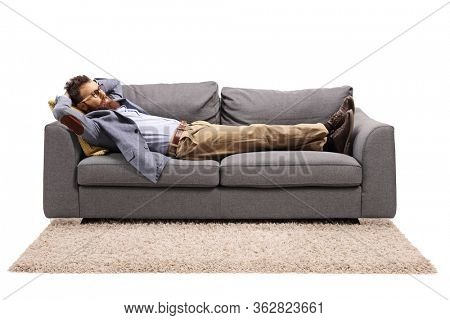 Bearded man resting on a couch after work isolated on white background
