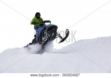 Adventurous Man Riding A Snowmobile In White Snow. White Background Isolated Cutout. Perfect For Ima