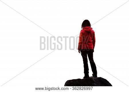 Adventurous Female Hiker Standing On Top Of A Steep Rocky Cliff. White Background Isolated Cutout. P