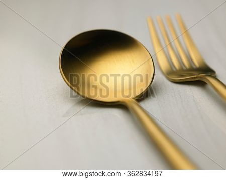Close-up of spoon And fork over marble table