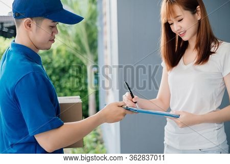 Door To Door Asian Deliveryman Express Sending Send A Package To Customer Receiver Sign Checking Shi